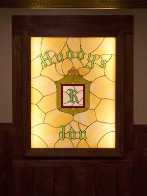 This stained glass panel from the old Huddy's Inn graces a hallway in the new restaurant.