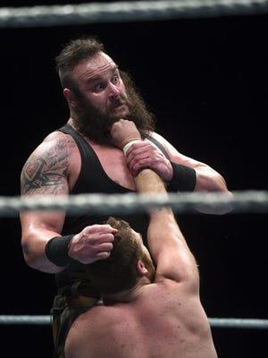 Sami Zayn grabs the beard of Braun Strowman during the WWE Raw Live performance at the Garrett Coliseum on Jan. 7.
