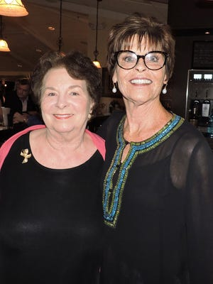 Jody Bond and event co-chair Maggie Duffy share smiles at the event's success.