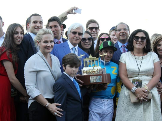 Bob Baffert, trainer, Victor Espinoza, jockey, Ahmed Zayat, owner, pose with family after American Pharoah won the 2015 William Hill Haskell Invitational at Monmouth Park in Oceanport, NJ Sunday, August 2, 2015.