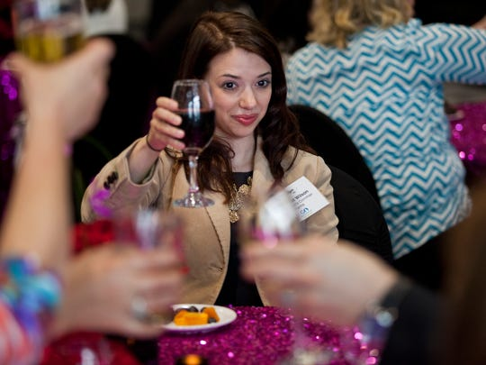 Margaret Wilson from Zingerman's Cornman Farms offers a toast to others at her table during the Best of Michigan award ceremony hosted by ÒMichigan Meetings and EventsÓ magazine Thursday, May 14, 2015 at the Blue Water Convention Center in Port Huron.