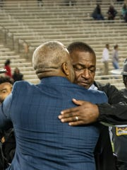 ASU President Quinton Ross with interim head coach Donald Hill-Eley after the Grambling State game at ASU Stadium.