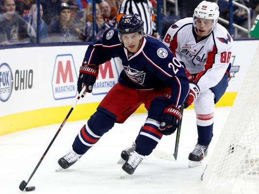 Washington Capitals' Nate Schmidt, right, chases Columbus Blue Jackets' Brandon Saad behind the net during the second period of an NHL hockey game, Tuesday, Jan. 19, 2016, in Columbus, Ohio. (AP Photo/Jay LaPrete)