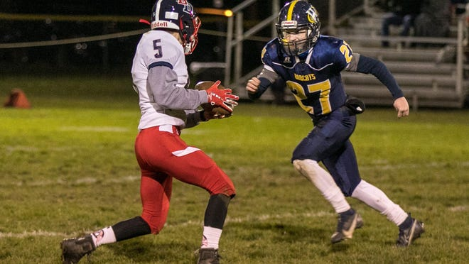 Britton Deerfield's Wyatt Carr runs with the ball during Friday's game at Whiteford.