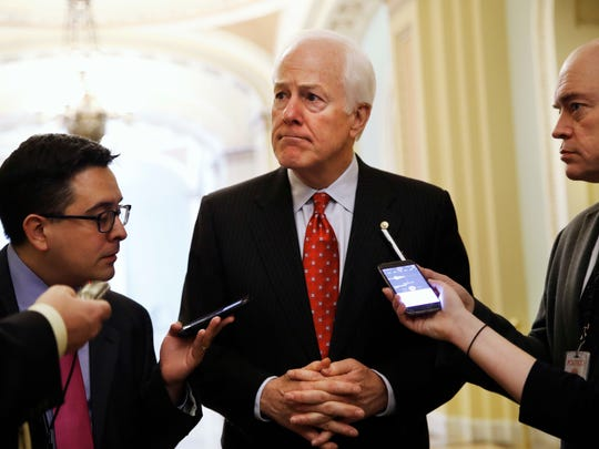 Sen. John Cornyn talks with reporters about President Trump's decision to fire James Comey on May 10, 2017, on Capitol Hill.