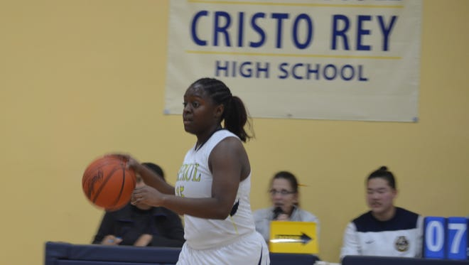 Heaven Evans, No. 15, takes the ball down court in the 52-33 win over the Temple Christian Tigers Jan. 25.