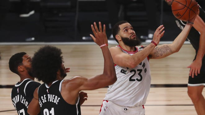 Toronto Raptors guard Fred VanVleet (23) goes up to shoot past Brooklyn Nets center Jarrett Allen (31) and guard Garrett Temple (17) during the second half of Game 1 of an NBA basketball first-round playoff series, Monday, Aug. 17, 2020, in Lake Buena Vista, Fla.