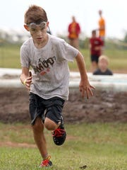 A determined 7-year-old Judson Morrison completes the