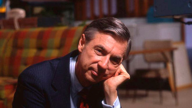 "This image released by Focus Features shows Fred Rogers on the set of his show ""Mister Rogers' Neighborhood"" from the film, ""Won't You Be My Neighbor?."" A new Fred Rogers Trail promoted by VisitPA.com includes museums, memorials and other sites. This year marks the 50th anniversary of ""Mister Rogers' Neighborhood"" and the new documentary ""Won't You Be My Neighbor?"" has helped rekindle interest in his legacy. (Jim Judkis/Focus Features via AP)"