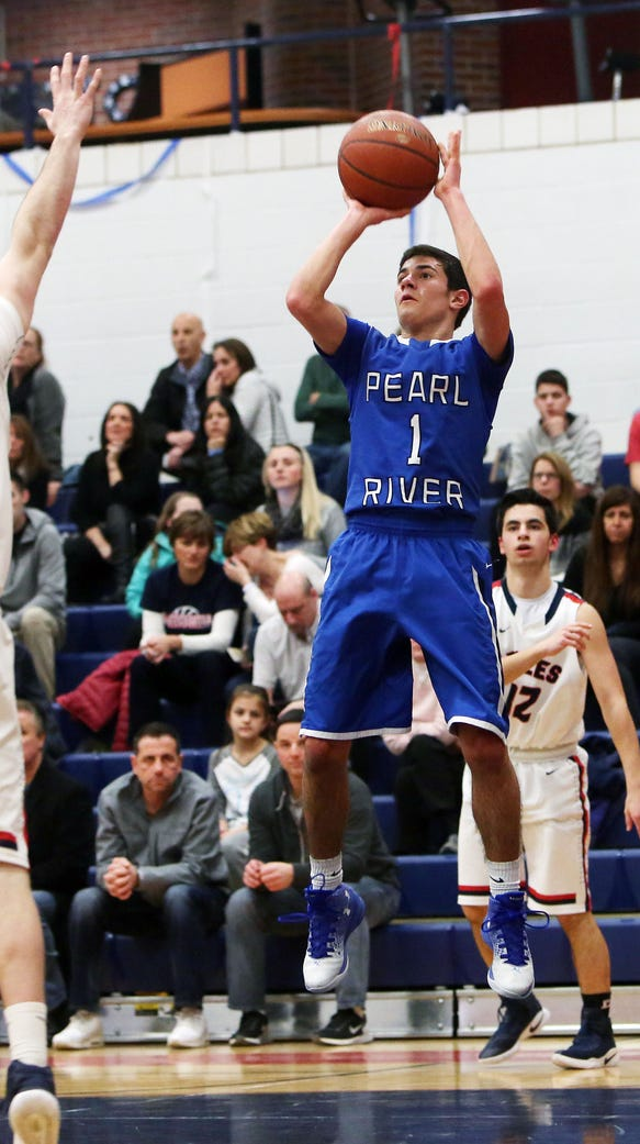 Pearl River's Stephen Lappas (1) puts up a shot in