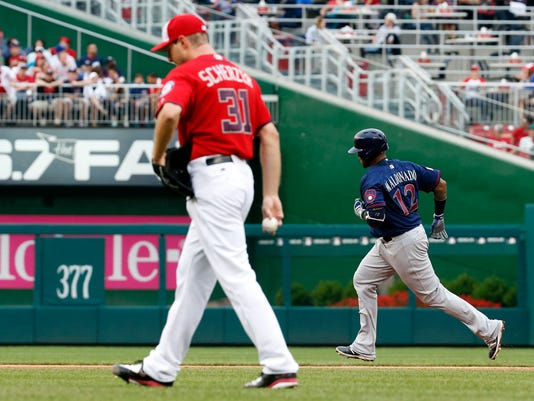 Milwaukee Brewers' Martin Maldonado (12) rounds the bases for a solo home run off Washington Nationals starting pitcher Max Scherzer (31) during the fifth inning of a baseball game at Nationals Park, Monday, July 4, 2016, in Washington. (AP Photo/Alex Brandon)
