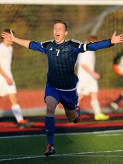 Brockport's Colby Wharram celebrates his first half goal in a 2-1 win over Brighton to win the Class A1 championship.
