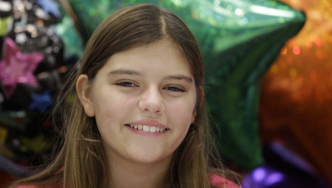 Kali Hardig, 12, who survived a rare and often fatal infection caused by a brain-eating amoeba, speaks to reporters at Arkansas Children's Hospital in Little Rock before being released Sept. 11, 2013.