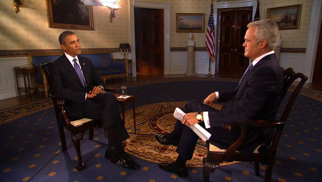 In this handout photo provided by CBS News, President Obama speaks with CBS Evening News anchor Scott Pelley at the White House on Sept.  9, 2013.