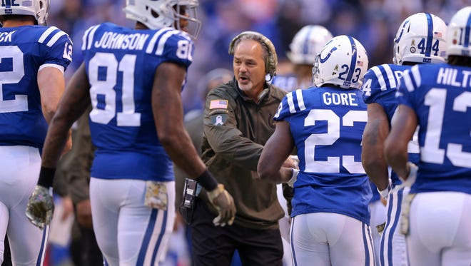 Indianapolis Colts head coach Chuck Pagano greets the offense on the sideline after scoring during the first half of an NFL football game Sunday, Nov. 8, 2015, at Lucas Oil Stadium.