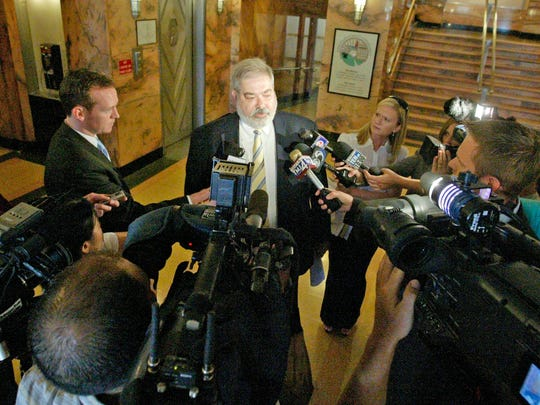 District Attorney Joe DeCecco answers questions from the media in the Sheboygan County Courthouse lobby Thursday July 3, 2008.