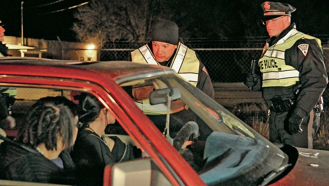 New Mexico State Police officers question a driver during a DWI checkpoint in Santa Fe in 2011. Lawmakers in 2016 have pre-filed dozens of bills aimed at increasing penalties for drunken drivers and child abusers.