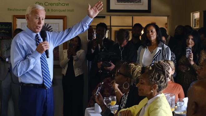 FILE - In this July 18, 2019, file photo, Democratic presidential candidate former Vice President Joe Biden speaks to community faith leaders after serving breakfast during a visit to Dulan's Soul Food on Crenshaw in Los Angeles. More than traditional markers of electability like name recognition, fundraising ability or charisma, the path to the Democratic nomination runs through black voters.