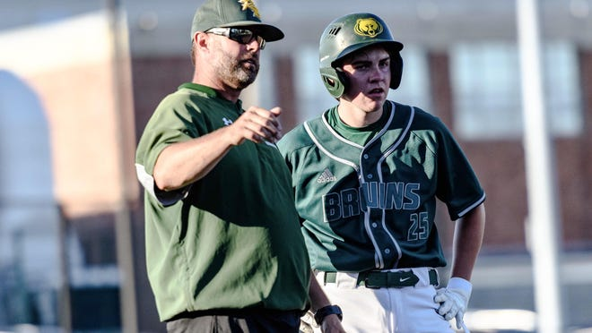 Rock Bridge head coach Justin Towe, left, talks with Owen Wise (25) during a summer baseball game Tuesday at Hickman.