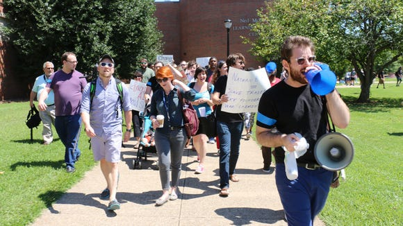 Middle Tennessee State University students, alumni and faculty march across campus chanting against the name of Forrest Hall on Aug. 27. (Sarah Taylor)