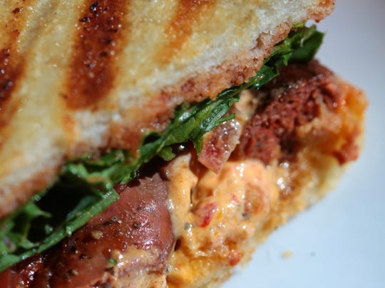 Clementine Gourmet Marketplace & Cafe in Palm Desert serves a Marrakech Pannini featuring Merguez sausage with Harissa Aioli and Moroccan ketchup.