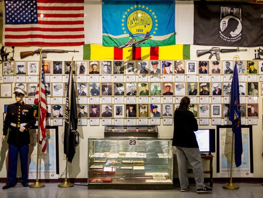 Traci Dewald of Muskegon views the 'Wall of Honor'