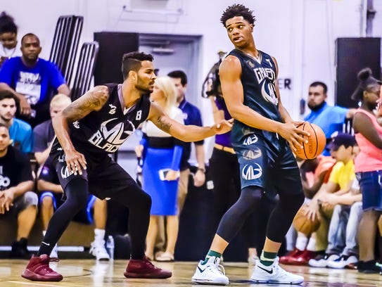 Michigan State's Miles Bridges, here defended by former