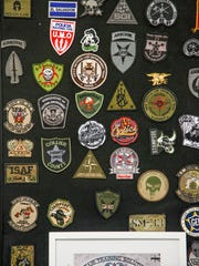 Brian Jones, Chief Executive Officer, and his wife Michelle Jones, Executive Vice President, of ALTAIR Training Solutions, Inc. They keep a board of patches to show who they have said they have trained.