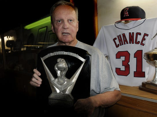 Dean Chance poses with the 1964 Cy Young Award he won