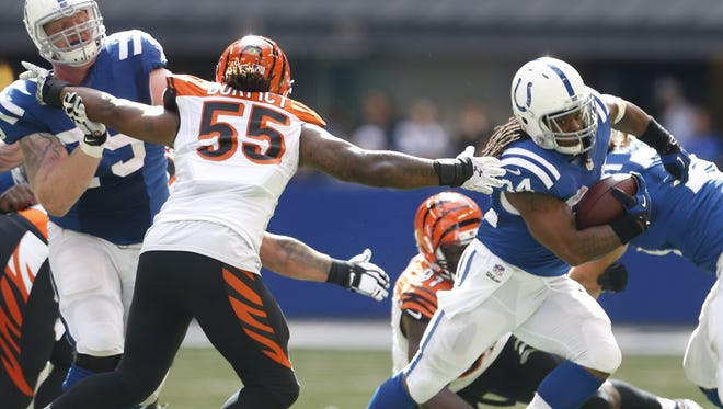 Indianapolis Colts running back Trent Richardson (34) moves the ball against the Cincinnati Bengals outside linebacker Vontaze Burfict (55) during the first quarter.