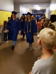 Stayton High School Class of 2017 graduates walked through the hallways of their former schools on graduation day, visiting with students teachers and staff.