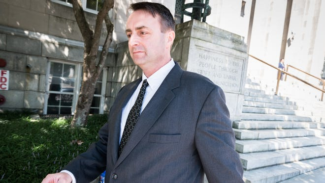 Michael Greene, former Buncombe County business intelligence manager leaves the federal courthouse in Asheville after his plea hearing for his guilty plea to a charge of conspiracy to defraud the federal government Friday, July 27, 2018. He has been ordered to forfeit $11,732.