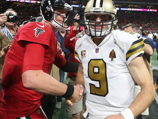 Atlanta Falcons quarterback Matt Ryan (2) speaks with New Orleans Saints quarterback Drew Brees (9) after an NFL football game, Thursday, Dec. 7, 2017, in Atlanta. The Falcons won 20-17.(AP Photo/John Bazemore)