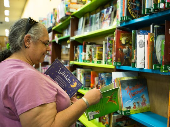 Las Cruces residence Trish Mullen looks at books for
