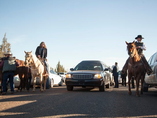 """Friends and family mourn at the funeral of Robert """"LaVoy"""""""