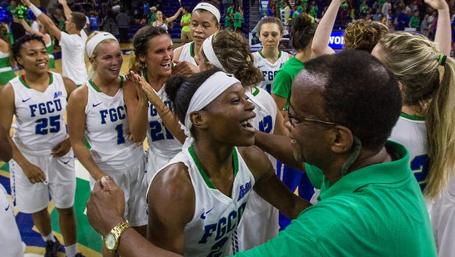 FGCU president Wilson Bradshaw congratulates Kaneisha Atwater after the Lady Eagles basketball team defeated Hofstra University Monday evening at Alico Arena during the WNIT quarterfinals. The final score was FGCU 61, Hofstra University 46.