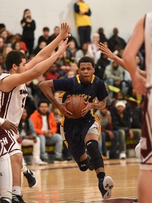 Pocomoke's Tyrone Matthews drives a lane against Snow Hill Thursday in Snow Hill.