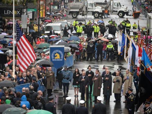 Dignitaries, including U.S. Vice President Joe Biden, survivors and first responders participate in a flag raising ceremony at the Boston Marathon.