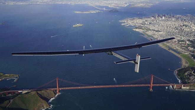 Solar Impulse 2 flies above San Francisco's Golden Gate Bridge before landing  at Moffett Airfield in April 2016, completing the Pacific crossing.