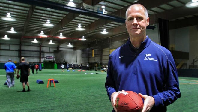 Mark Herrmann of St. Vincent Sports Performance, poses for a photo as he works with clients at The Sports Zone, Tuesday, January 28, 2014, training SVSP athletes and preparing them for the NFL Combine held in Indianapolis in February.