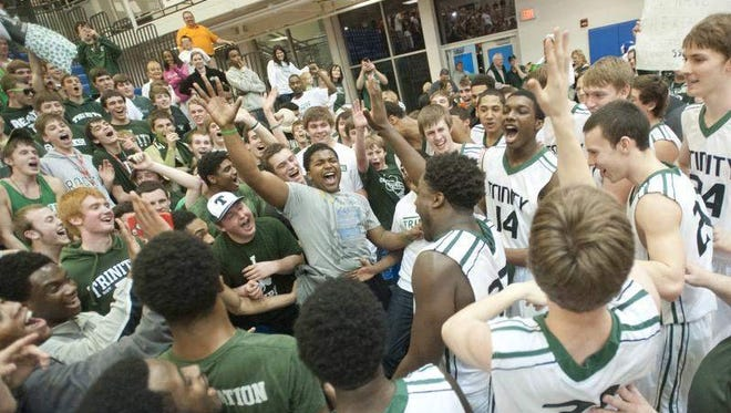 Fans join the team in celebration of the Shamrocks' rally from a 56-50 deficit to win the regional title.