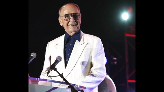 Jim Houston receives the Jeanette Rockefeller Humanitarian Award at the Evening Under the Stars event at the O'Donnell Golf Course in Palm Springs, raising funds for the AIDS Assistance Program in 2014.