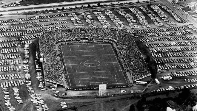 A crowd of 20,005 watches the Rochester Lancers play the New York Cosmos in playoff game.