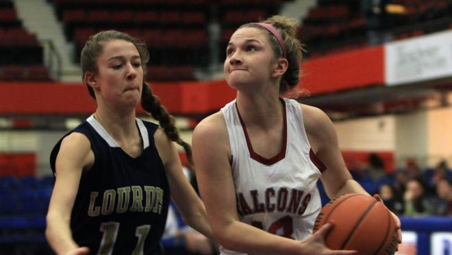 From right, Albertus Magnus' Kelly Guarino (13) drives to the basket in front of Lourdes' Emily Ferreri (11) during girls basketball action in the Slam Dunk Tournament at the Westchester County Center in White Plains Dec. 26, 2013. Albertus Magnus won the game 57-53.
