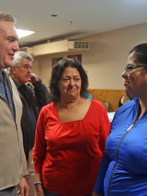 Marina Gutierrez, center, with her daughter, Emily Dominguez, and UNION Restaurant manager Paolo Feteira at Haverstraw Neighborhood Organization's 23rd annual Thanksgiving meal at the Quisqueya Sports Club in Haverstraw in 2016.