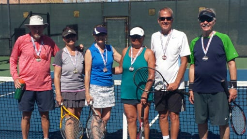 The mixed senior doubles winners at the Mesquite Senior Games: Gold – Darcel Prescott and Bill Glenn; Silver – Hinano Williams and Brent Miner; Bronze – Cindy Howa and Kevin Johansen.