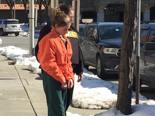 Jessica Crandall is taken to jail Friday after being