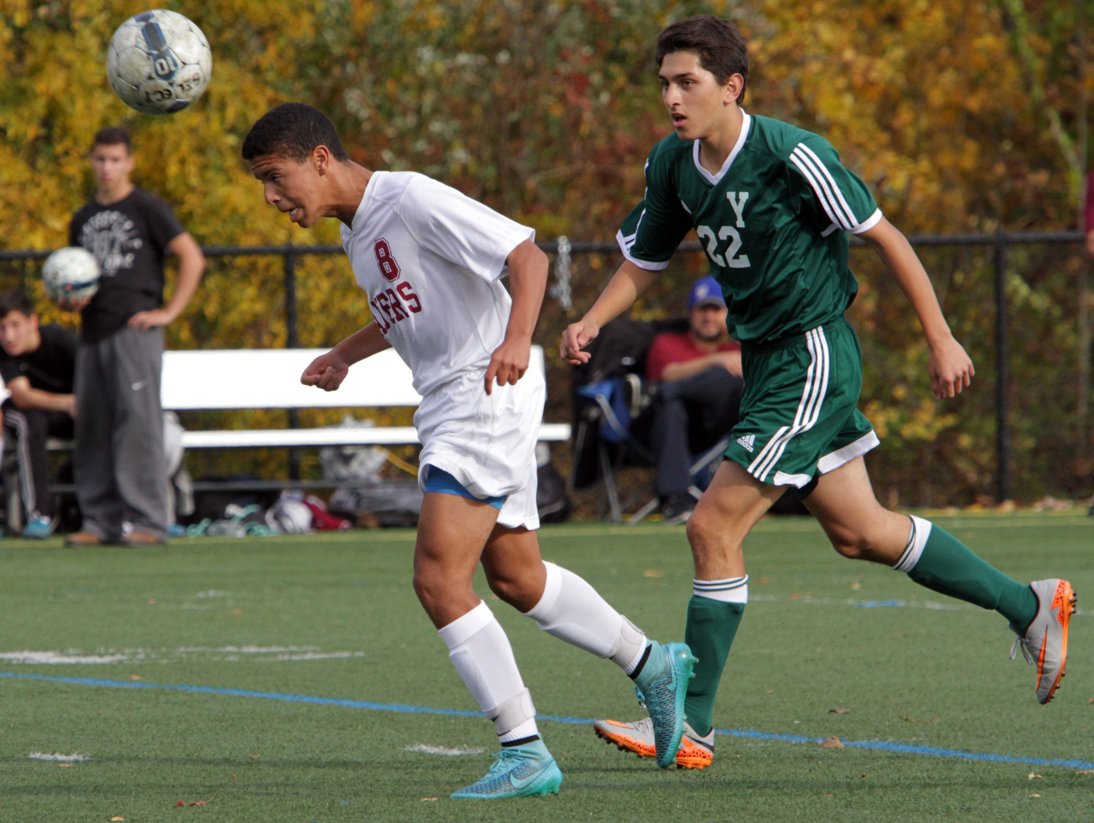 Chris Gaujean of Scarsdale heads the ball away from Ankit Patel of Yorktown during their Class AA boys soccer semifinal at Purchase College Oct. 29, 2105.