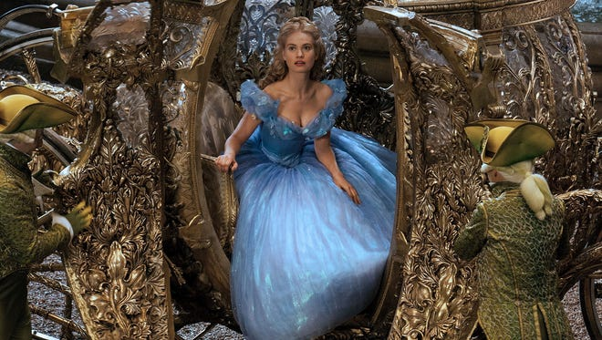 "Lily James is Cinderella in a scene from the motion picture ""Cinderella."""