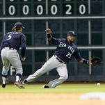 Seattle Mariners' Rickie Weeks (25) allows the ball to drop as shortstop Brad Miller (5) watches during the baseball game against the Houston Astros  Saturday May 2, 2015, in Houston.